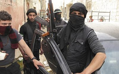 Free Syrian Army fighters are seen in a neighborhood of Damascus, Syria, on Sunday. (photo credit: AP)