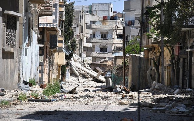 A residential neighborhood in Homs following a government bombardment earlier this year (photo credit: AP)