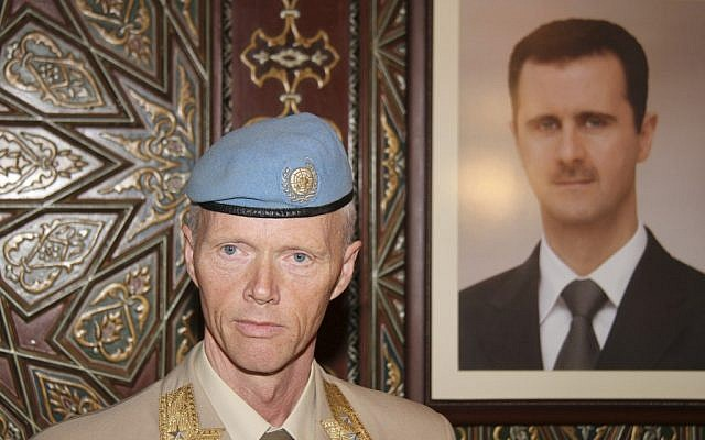 Norwegian General Robert Mood stands near a portrait of Bashar Assad in Damascus (photo credit: AP/Bassem Tellawi)