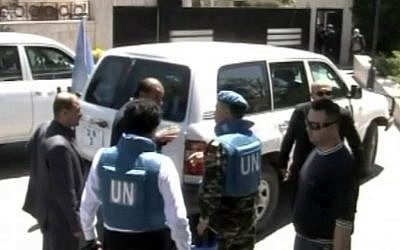 UN observers visiting Homs, Syria, on Saturday. (photo credit: AP/Syria TV via AP video)