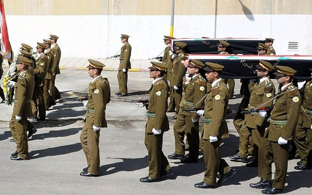 In this photo released by Syria's official news agency SANA, Syrian honor guard soldiers carry the coffins of army soldiers who were killed in recent violence in the country, April 24, 2012 (AP Photo/SANA)