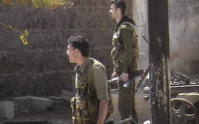 Syrian security forces in a neighborhood in Daraa (photo credit: AP Photo/Local Coordination Committees in Syria)