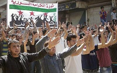 Syrian opposition demonstrators in Idlib in early April (photo credit: AP)