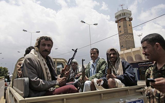 Yemeni policemen sit in a pickup truck in front of Sanaa's International airport. (photo credit: AP/Hani Mohammed)