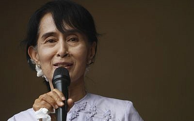 Myanmar's pro-democracy leader Aung San Suu Kyi addresses her supporters and media at the headquarters of her National League for Democracy party April 2. (photo credit: AP Photo)
