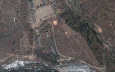 This satellite image from April 18, 2012, provided by GeoEye, appears to show a train of mining carts at North Korea's Punggye-ri nuclear test site. (AP Photo/GeoEye)