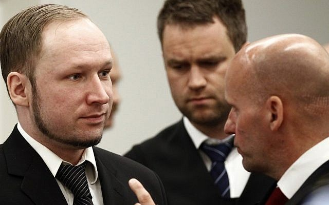 Anders Breivik (left) with his lawyers in court on Wednesday (photo credit: Lise Aserud/AP)