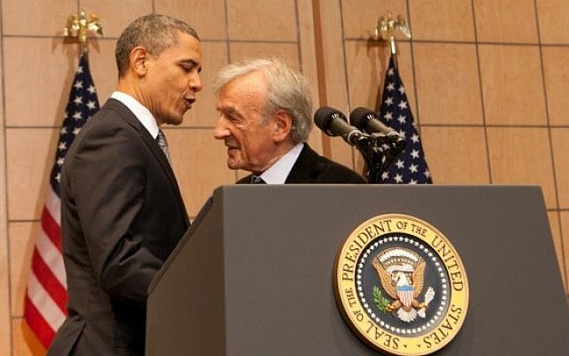 Then US president Barack Obama embraces Elie Wiesel before delivering a speech about the Holocaust and its meaning at the US Holocaust Memorial Museum, April 23, 2012. (Courtesy USHMM/JTA)