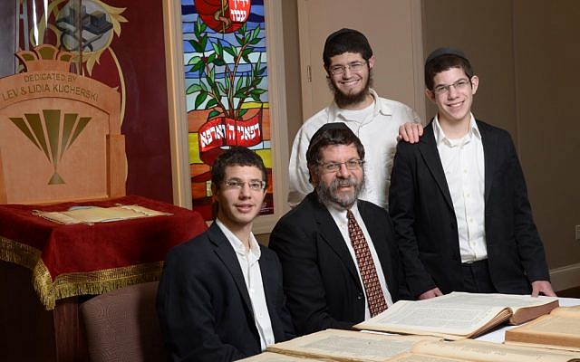 Rabbi Areyah Kaltmann and his sons. Kaltmann bought rare Talmuds the U.S. Army authorized for publication. (photo credit: AP/HO, Lorn Spolter)