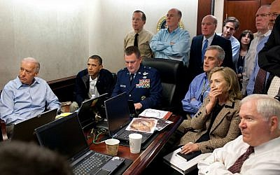 US Secretary of State Hillary Rodham Clinton, at right with hand covering mouth, President Barack Obama, second from left, Vice President Joe Biden, left, Secretary of Defense Robert Gates, right, and members of the national security team watch an update on the mission against Osama bin Laden in the White House Situation Room on May 1, 2011. The image, released by the White House, was digitally altered by the source to obscure the details of a document in front of Secretary Clinton. (AP Photo/The White House, Pete Souza)