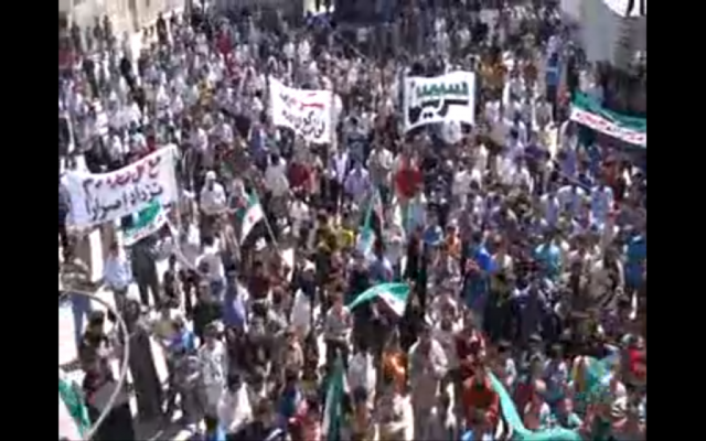 Image capture of Syrian protesters on Friday from a YouTube video.
