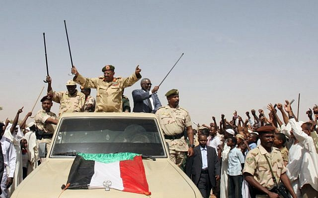 Sudanese President Omar Al-Bashir addressing a military unit in April, 2012. (photo credit: AP/Abd Raouf)
