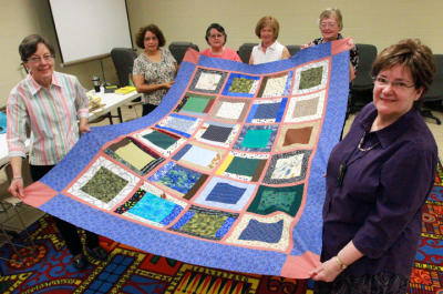 Susy Rothschild, lower right, and the other members of the West Side Quilting Bee have produced a scrap quilt destined for Israel. The group meets regularly at the Westside library branch at Belvidere and N. Mesa. The other quilters are from left: Gail Mark, Dolly Montiel, Pat Baca, Inga Ewozniak and Ann Geiyer. Rudy Gutierrez/El Paso Times
