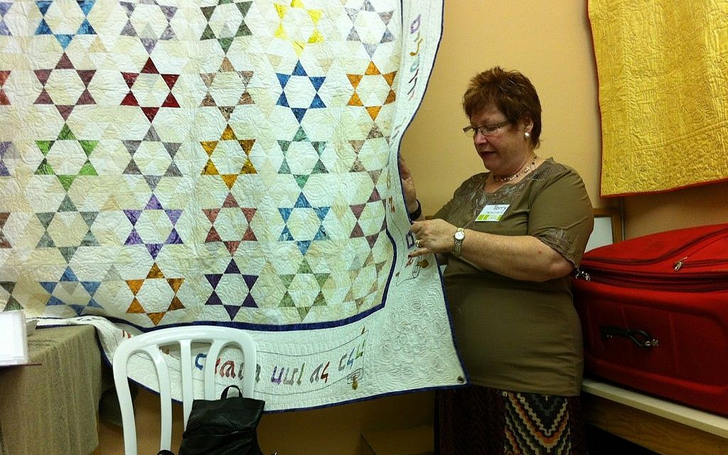 Terry Mowszowski examines one of the quilts destined for Benji's Home (courtesy: Terry Mowszowski)
