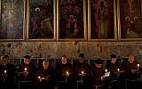Catholic clergy attend a procession during Holy Saturday inside the Church of the Holy Sepulchre (photo credit: AP/Bernat Armangue)