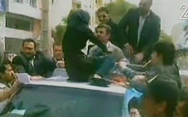 A female protester confronts Mahmoud Ahmadinejad in Bandar-Abbas. (photo credit: Channel 2 screen capture)