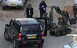 A police bomb squad unit neutralized a bomb hidden in a jeep in Bnei Brak in January, 2011 (photo credit: Roni Schutzer/Flash90)