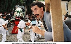 The 2006 film 'Borat' depicted an absurd 'Running of the Jew' ceremony. In Mexico, a newspaper is reporting on a genuine 'Burning of the Jews' event. (Illustrative photo credit:  Ruben Fleischer/20th Century Fox)