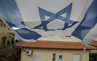 A flag hangs near a house in the settlement of Bruchin (photo credit: Uri Lenz/Flash90)