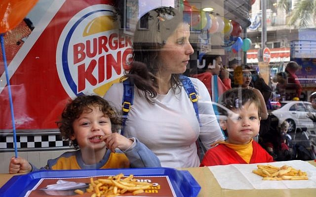 Israeli kids enjoying some french fries at a Burger King in Tel Aviv, 2009. (photo credit: Serge Attal/Flash90/File)