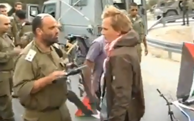Lt. Col. Shalom Eisner facing Danish pro-Palestinian protester Andreas Ayas (screen capture: from YouTube)