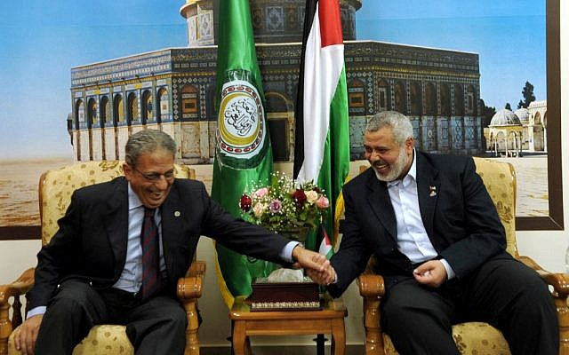 Amr Moussa (left) jokes with Hamas prime minister Ismail Haniyeh during a visit to Gaza in 2010 (photo credit: Abed Rahim Khatib/Flash 90)
