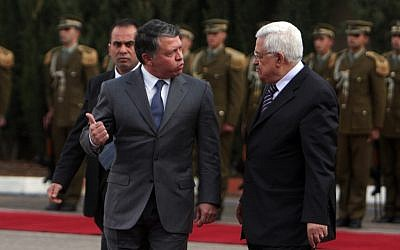 Jordan's King Abdullah (left), pictured with Palestinian Authority President Mahmoud Abbas on a visit to Ramallah in November, 2011. (Issam Rimawi/Flash90)