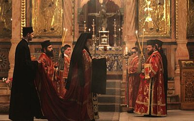 Greek Orthodox clergymen attend a procession inside the Church of the Holy Sepulchre in Jerusalem's Old City (photo credit: Nati Shohat/Flash90/File)