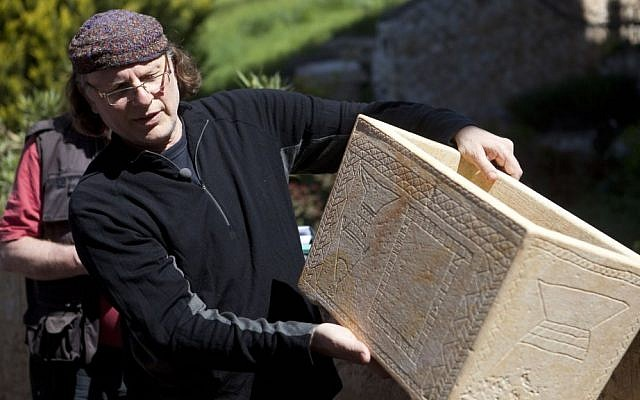 Documentary filmmaker Simcha Jacobovici shows a life-size replica of one of the ossuaries found in 'Patio Tomb,' a first century burial cave located beneath an apartment building, on April 4, 2012 in Jerusalem, Israel. (Lior Mizrahi / FLASH 90)