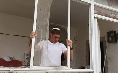 Jewish resident working on a house in Beit Hanina that was legally purchased by Jews (photo credit: Flash 90)