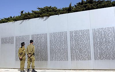 Soldiers stand near a wall with names of fallen soldiers of the IDF armored corps in Latrun (photo credit: Yoav Ari Dudkevitch/Flash90)