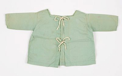 The shirt worn by Nina Denty Abayov's baby brother, found in their Athens home after the war (Courtesy Yad Vashem)
