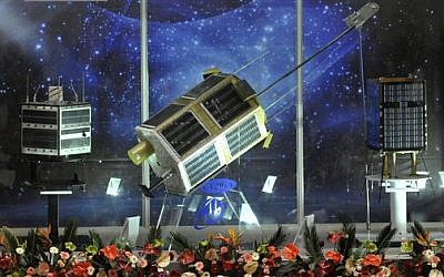 Models of Iranian-built satellites on display in Tehran (photo credit: AP)