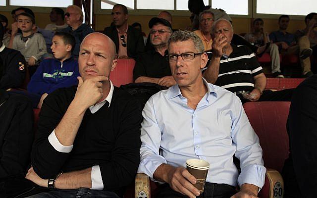 Former Dutch soccer player Jordi Cruyff (left) sits with the owner of Maccabi Tel Aviv soccer team Mitchell Goldhar during a game in Ashdod on Saturday (photo credit: Tsafrir Abayov/Flash90)