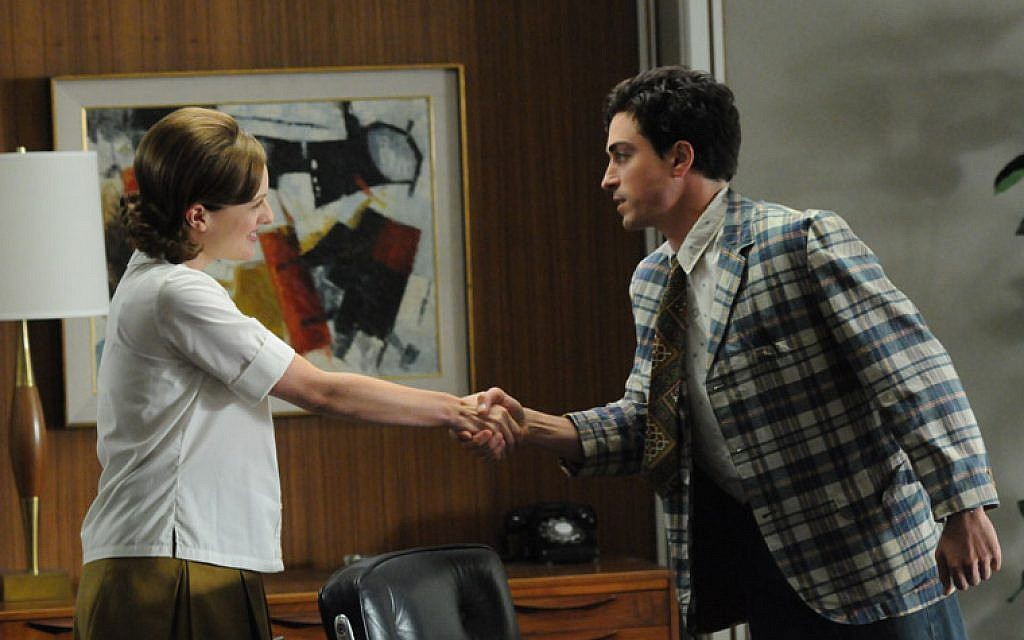 Michael Ginsberg (Ben Feldman) and Peggy Olson (Elisabeth Moss) in 'Mad Men'. (photo credit: AMCTV)