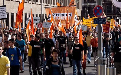 Pirate Party members during a demonstration in 2010 (photo credit: CC-BY: Tobias M. Eckrich)