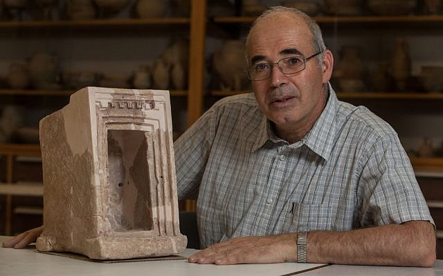 Yosef Garfinkel with a shrine model made of stone, found at Hirbet Qeiyafa (Courtesy of Hebrew University of Jerusalem)