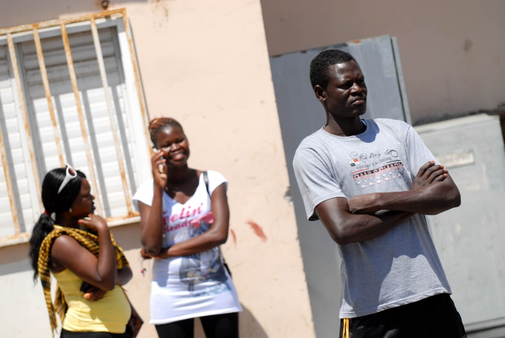 African immigrants in South Tel Aviv. The Interior Ministry is offering cash incentives and a plane ticket to those who leave willingly in the next week or two. Otherwise, they'll be expelled, adds the ministry. photo credit: Tomer Neuberg/Flash90)