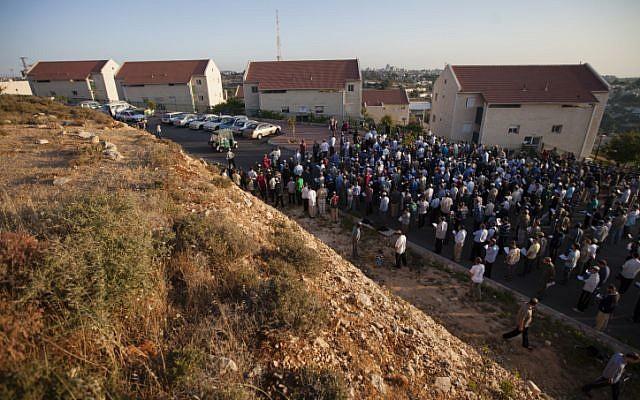 A prayer service held Monday outside the Ulpana neighborhood houses slated for demolition (Photo credit: Flash 90)