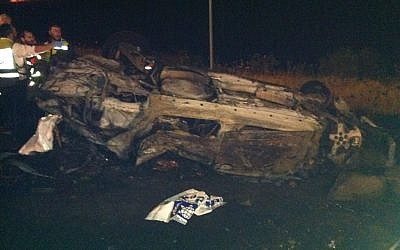 Remains of car in which eight members of the Attias family were killed early Tuesday morning (photo credit: courtesy Israel Police)