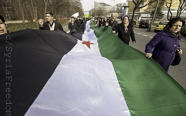 A protest outside the Syrian Embassy in Berlin in March. (photo credit: CC-BY FreedomHouse2, Flickr)