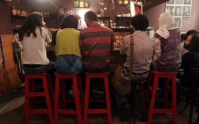 Iranian youths sit at a cafe in Tehran (AP/Hasan Sarbakhshian)