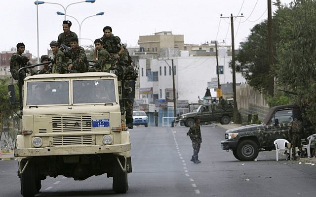 Troops patrol outside the US Embassy in Sanaa in 2008. (photo credit: AP/Nasser Nasser)