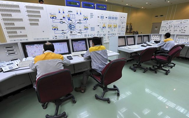 Iranian technicians work at the Bushehr nuclear power plant in 2010 (photo credit: AP/IIPA, Ebrahim Norouzi)