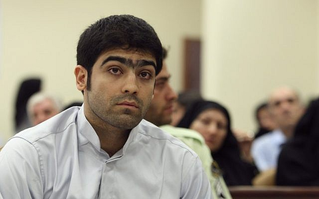 Majid Jamali Fashi listens to the judge at his trial last August (photo credit: AP Photo/Vahid Salemi)
