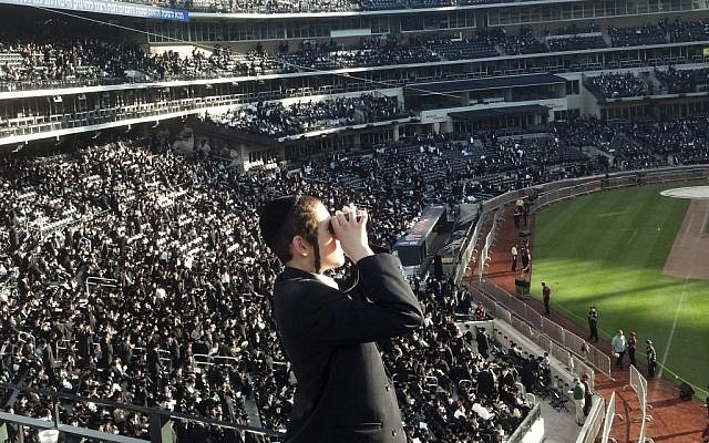 Ultra-Orthodox Jews at Citi Field in New York Sunday for a gathering on Internet usage. (photo credit: AP/VosIzNeias.com
