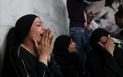 Egyptian women mourn the death of protesters in Cairo Wednesday (photo credit: AP/Mohammed Asad)