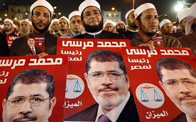 Several hundreds Imams listen to Muslim Brotherhood's presidential candidate Mohammed Morsi at a rally in Cairo, Egypt, Sunday, May 20, 2012. (photo credit: AP/Fredrik Persson)