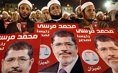 Several hundreds Imams listen to Muslim Brotherhood's presidential candidate Mohammed Morsi at a rally in Cairo, Egypt, Sunday, May 20, 2012 (photo credit: AP Photo/Fredrik Persson)