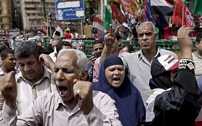 Egyptian demonstrators gather to denounce the electoral success of Ahmed Shafiq, Mubarak's last prime minister, in Tahrir Square in Cairo, Egypt on Friday. (photo credit: Pete Muller/AP)